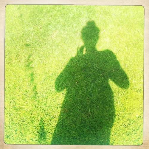 my shadow on the grass